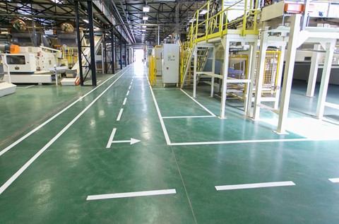 Emerald Green Epoxy Finish Installed in Philip Morris' New Plant
